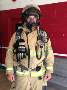 Minden fireman Tony Hall demonstrates how to wear the equipment